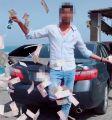 شرطة دبي تطيح بشاب ظهر في فيديو وهو يرمي الأموال في الشارع بقصد التباهي